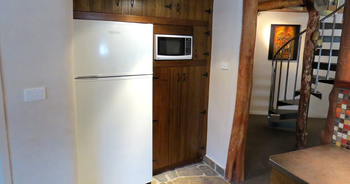 Kitchen cupboards in a straw bale house