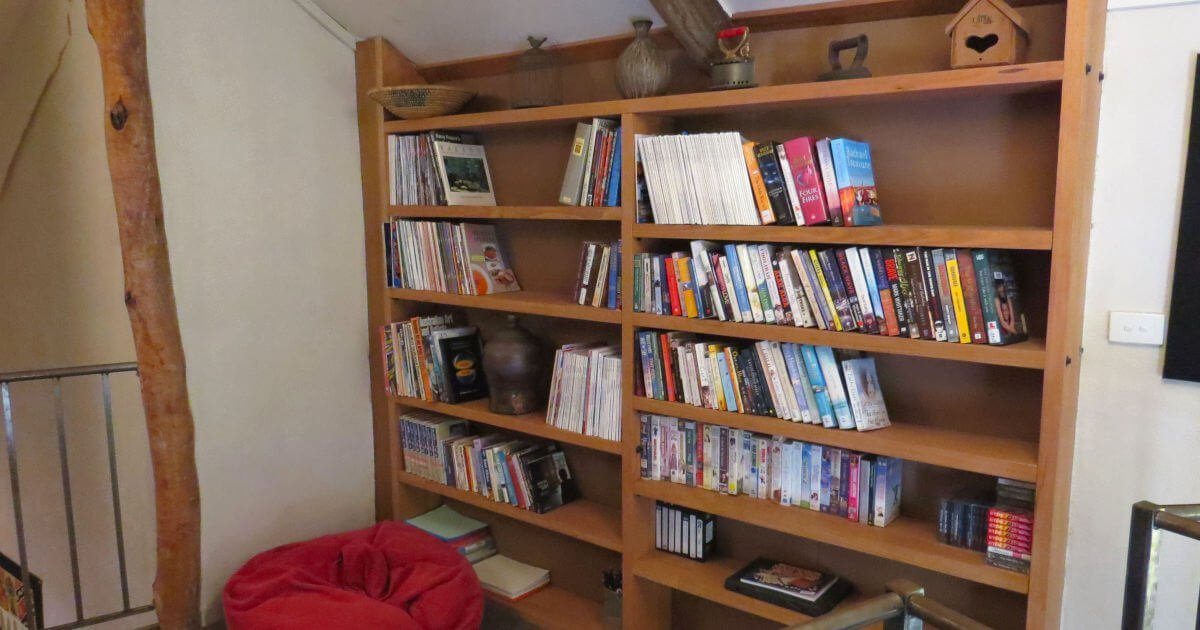 A book shelf and bean bag make this cozy reading corner on the mezzanine complete