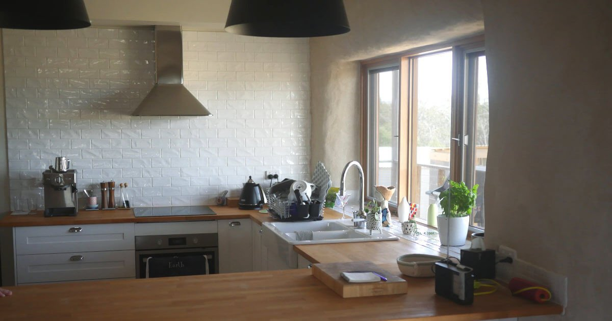 This client's straw bale kitchen is so open and light