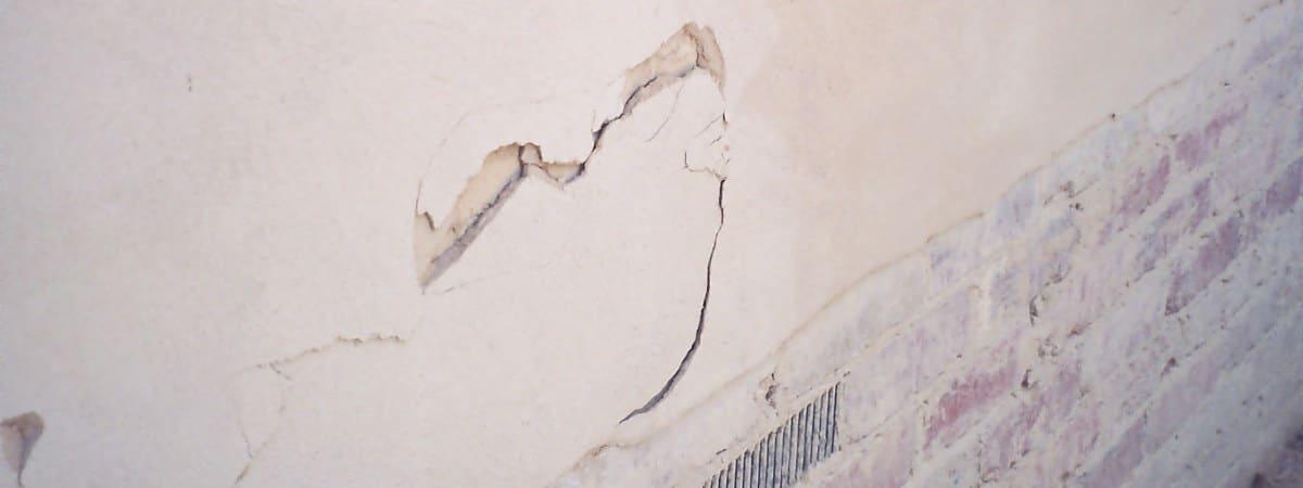 damaged straw bale wall